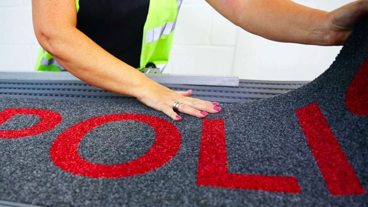 Plastex matting with a custom-made logo panel.