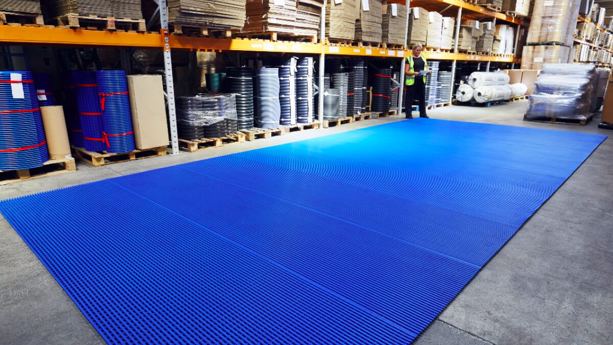 A Plastex team member inspects a roll of matting at our UK factory.