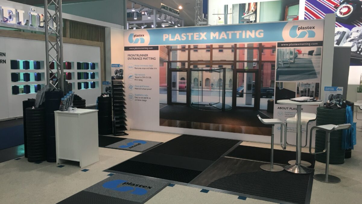 Plastex protective matting on display at a trade show in Europe.