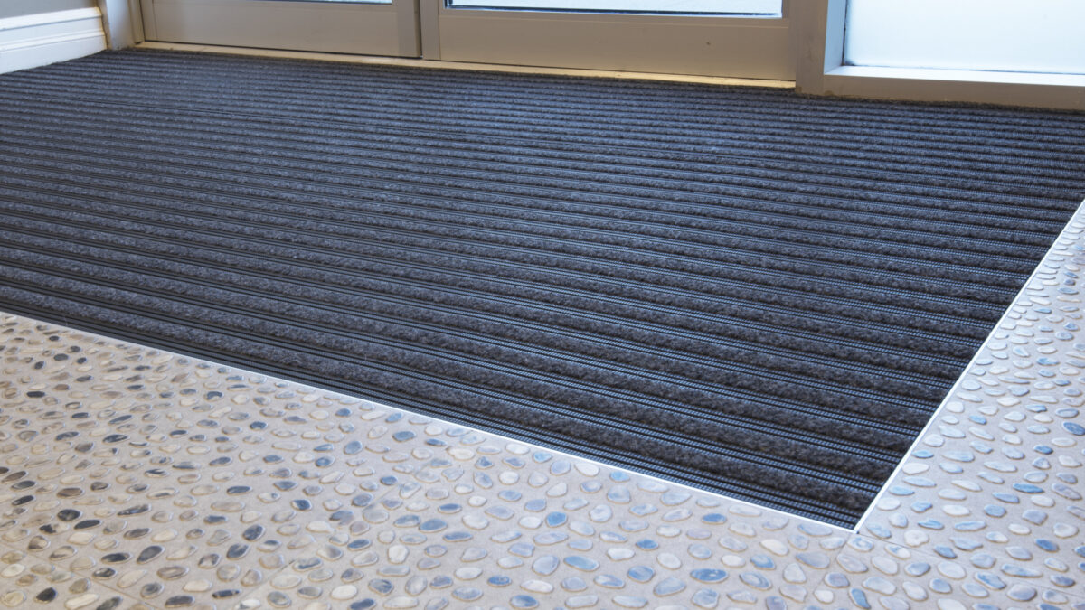 Frontrunner SB+ is solid-backed entrance matting with carpet inserts.